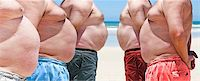 Five obesely fat men on the beach Stock Photo - Royalty-Freenull, Code: 400-06357974