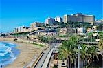 TARRAGONA, SPAIN - NOVEMBER 23: Miracle Beach and panoramic view of the city on November 23, 2011 in Tarragona, Spain. This beach, the closest to downtown, is 980 meters long and 52 meters wide Stock Photo - Royalty-Free, Artist: nito                          , Code: 400-06362677