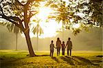 Asian family holding hands and walking towards light Stock Photo - Royalty-Free, Artist: szefei                        , Code: 400-06363765