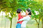 Asian mother hugging her daughter at outdoor park Stock Photo - Royalty-Free, Artist: szefei                        , Code: 400-06363768