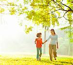 Asian mother and daughter holding hands walking at outdoor park Stock Photo - Royalty-Free, Artist: szefei                        , Code: 400-06363772
