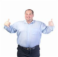 Happy Fat Man in a Blue Shirt, isolated Stock Photo - Royalty-Freenull, Code: 400-06366527