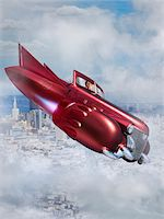 fantastically - Woman Flying Jet Car over City Stock Photo - Premium Rights-Managednull, Code: 700-06368057