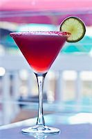 Hibiscus Infused Tequila Margarita with Sugared Rim and Lime Garnish Stock Photo - Premium Royalty-Freenull, Code: 659-06372328