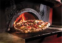 spicy - Pizza In Front of a Wood Fired Oven Stock Photo - Premium Royalty-Freenull, Code: 659-06372387