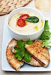 Bowl of Hummus with Pita Bread Stock Photo - Premium Royalty-Free, Artist: Photocuisine, Code: 659-06372393