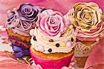Celebratory cupcakes decorated with buttercream and sugar roses Stock Photo - Premium Royalty-Free, Artist: Cultura RM, Code: 659-06372489
