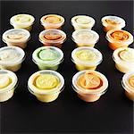 Various dips in small plastic bowls Stock Photo - Premium Royalty-Free, Artist: Photocuisine, Code: 659-06372861