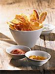 Potato chips with pepper salt, curry salt and celery salt Stock Photo - Premium Royalty-Freenull, Code: 659-06372880