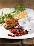 Vegetable fritters with a dip and dried tomatoes Stock Photo - Premium Royalty-Free, Artist: Blend Images, Code: 659-06372891