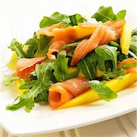 smoked - Arugula Salad with Salmon and Mango on a White Plate Stock Photo - Premium Royalty-Freenull, Code: 659-06372914