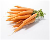 Whole Peeled Carrots Bundled with an Elastic Band Stock Photo - Premium Royalty-Freenull, Code: 659-06372999