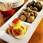 Three Part Serving Dish with Deviled eggs, Marinated Mushrooms and Olives; Bowl of Toothpicks Stock Photo - Premium Royalty-Freenull, Code: 659-06373050
