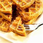 Stack of Five Grain Waffle with Organic Maple Syrup; Piece on a Fork Stock Photo - Premium Royalty-Freenull, Code: 659-06373056