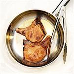 Two Seared Bone-In Pork Chops in a Skillet Stock Photo - Premium Royalty-Freenull, Code: 659-06373062