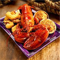 Seafood Platter with Lobster, Fried Shrimp and Stuffed Clams Stock Photo - Premium Royalty-Freenull, Code: 659-06373063