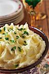Bowl of Creamy Mashed Potatoes with Parsley Stock Photo - Premium Royalty-Freenull, Code: 659-06373122