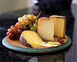 Assorted Cheese with Grapes on Bamboo Board Stock Photo - Premium Royalty-Freenull, Code: 659-06373162