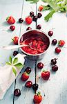 Strawberry jam in a pot, fresh cherries and strawberries Stock Photo - Premium Royalty-Freenull, Code: 659-06373221