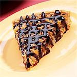 Slice of Pecan Tart with Chocolate Drizzle Stock Photo - Premium Royalty-Free, Artist: Andrew Kolb, Code: 659-06373392