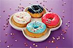 Four doughnuts with colourful glaze and sugar sprinkles Stock Photo - Premium Royalty-Free, Artist: TSUYOI, Code: 659-06373521