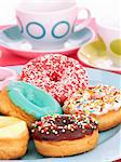 Colourful glazed doughnuts on a plate Stock Photo - Premium Royalty-Free, Artist: Yvonne Duivenvoorden, Code: 659-06373563