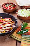 Chicken Fajita Skillet with Toppings; Jalapeno Stock Photo - Premium Royalty-Freenull, Code: 659-06373659