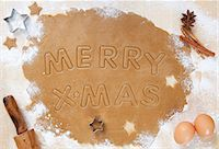 Cookie Dough Rolled Out with Merry X-Mas Cut Into It Stock Photo - Premium Royalty-Freenull, Code: 659-06373699