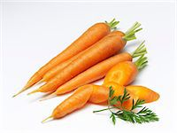 Carrots, whole and chopped Stock Photo - Premium Royalty-Freenull, Code: 659-06373778