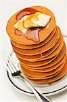 Tall Stack of Pancakes with Butter and Maple Syrup Stock Photo - Premium Royalty-Free, Artist: Jose Luis Stephens, Code: 659-06373812