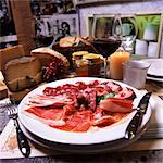 Piatto di salumi (an appetizer platter of salami and raw ham) Stock Photo - Premium Royalty-Freenull, Code: 659-06373834