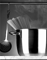 Spaghetti in a stainless steel pot and a hanging ladle Stock Photo - Premium Royalty-Freenull, Code: 659-06373839