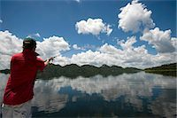 fishing - Man fishing from boat, Mazvikadei dam, Mashonlaland West Province, Zimbabwe Stock Photo - Premium Royalty-Freenull, Code: 682-06373926