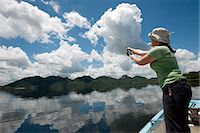 side view of person rowing in boat - Woman fishing from boat, Mazvikadei dam, Mashonlaland West Province, Zimbabwe Stock Photo - Premium Royalty-Freenull, Code: 682-06373927