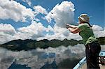 Woman fishing from boat, Mazvikadei dam, Mashonlaland West Province, Zimbabwe Stock Photo - Premium Royalty-Freenull, Code: 682-06373927