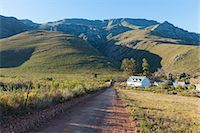 quaint house - An elevated view of a farmhouse nestled in a valley on the outskirts of the Overberg town of Greyton, Western Cape, South Africa Stock Photo - Premium Royalty-Freenull, Code: 682-06373951
