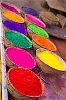 Collection of bright coloured powders for use in the making of Bindi's, taken at stall in Pushkar, Rajasthan, India Stock Photo - Premium Royalty-Freenull, Code: 682-06374019