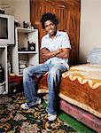 Portrait of an African man in his bedroom, Gugulethu, Cape Town Stock Photo - Premium Royalty-Free, Artist: Robert Harding Images, Code: 682-06374066