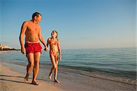 Father with daughter walking on beach Stock Photo - Premium Royalty-Freenull, Code: 6102-06374485