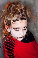 Portrait of girl with Halloween make up Stock Photo - Premium Royalty-Freenull, Code: 6102-06374495