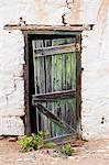 An old door hangs on it's hinges at an abandoned farm building. Stock Photo - Premium Royalty-Free, Artist: Strauss/Curtis, Code: 682-06374447