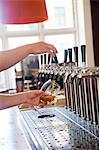 Bartender pulling beer Stock Photo - Premium Royalty-Free, Artist: RelaXimages, Code: 6102-06374557