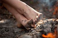 Low section of a girl with dirty feet in mud Stock Photo - Premium Royalty-Freenull, Code: 698-06374669