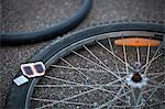Patch and metal chip on damaged bicycle wheel Stock Photo - Premium Royalty-Free, Artist: Masterfile, Code: 698-06374685