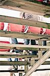 Low section of people sitting on bleachers Stock Photo - Premium Royalty-Free, Artist: Cultura RM, Code: 698-06374689