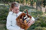 Happy mid adult woman looking at mushrooms in basket Stock Photo - Premium Royalty-Free, Artist: David & Micha Sheldon, Code: 698-06374744