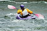 Rear view of a woman kayaking in river Stock Photo - Premium Royalty-Free, Artist: Blend Images, Code: 698-06374750