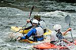 People kayaking in rapid river Stock Photo - Premium Royalty-Free, Artist: Blend Images, Code: 698-06374753