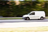 White delivery van moving fast on a country road Stock Photo - Premium Royalty-Freenull, Code: 698-06374779