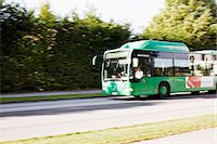 Green bus moving rapidly on highway Stock Photo - Premium Royalty-Freenull, Code: 698-06374781